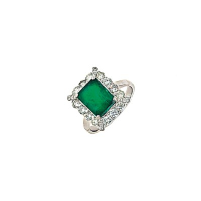 An 18ct white gold emerald and