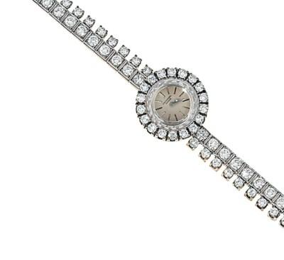 A diamond-set wristwatch, by U