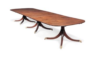 A LARGE MAHOGANY DINING TABLE