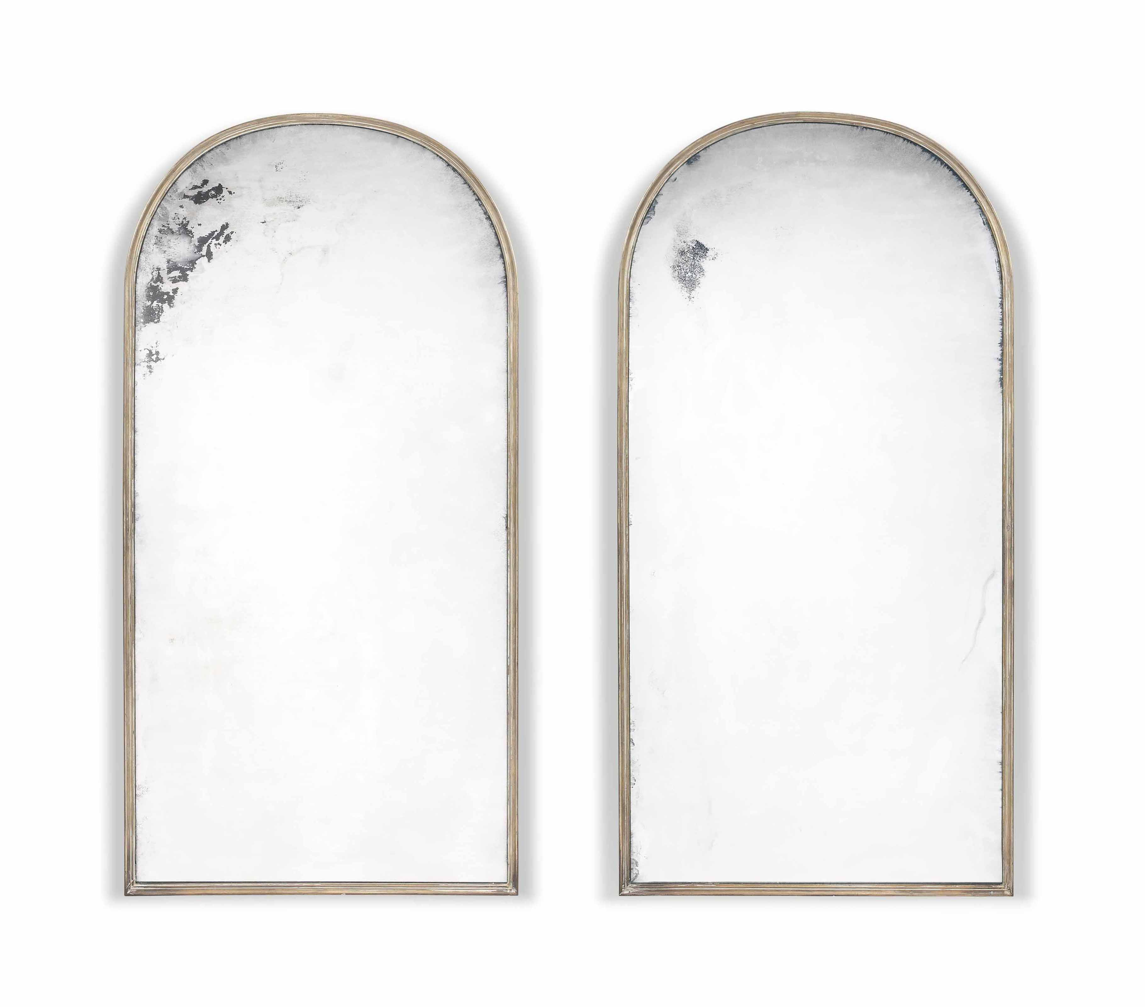 A PAIR OF BRASS-FRAMED MIRRORS