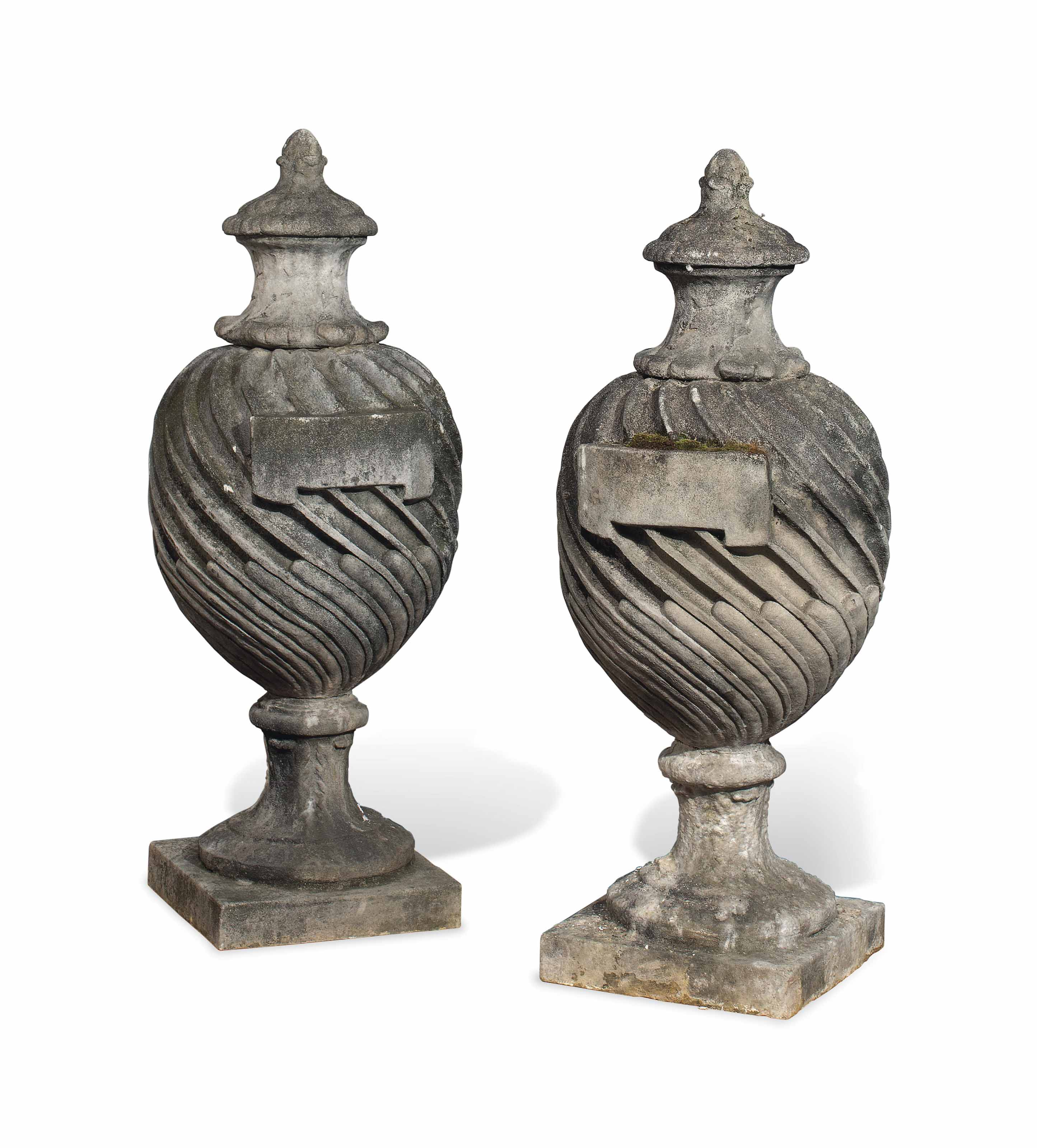 A PAIR OF COMPOSITION STONE UR
