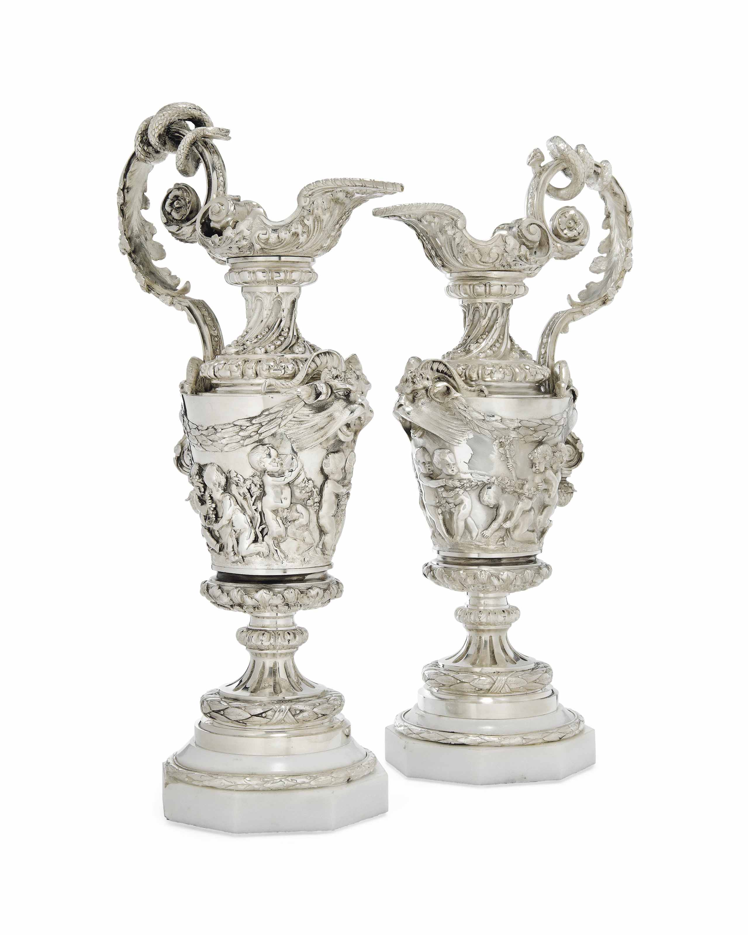 A PAIR OF SILVER-PLATED VASES