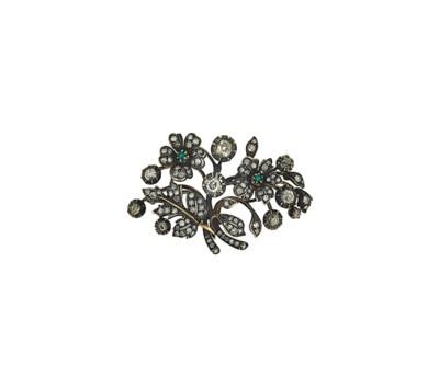 A diamond and emerald brooch