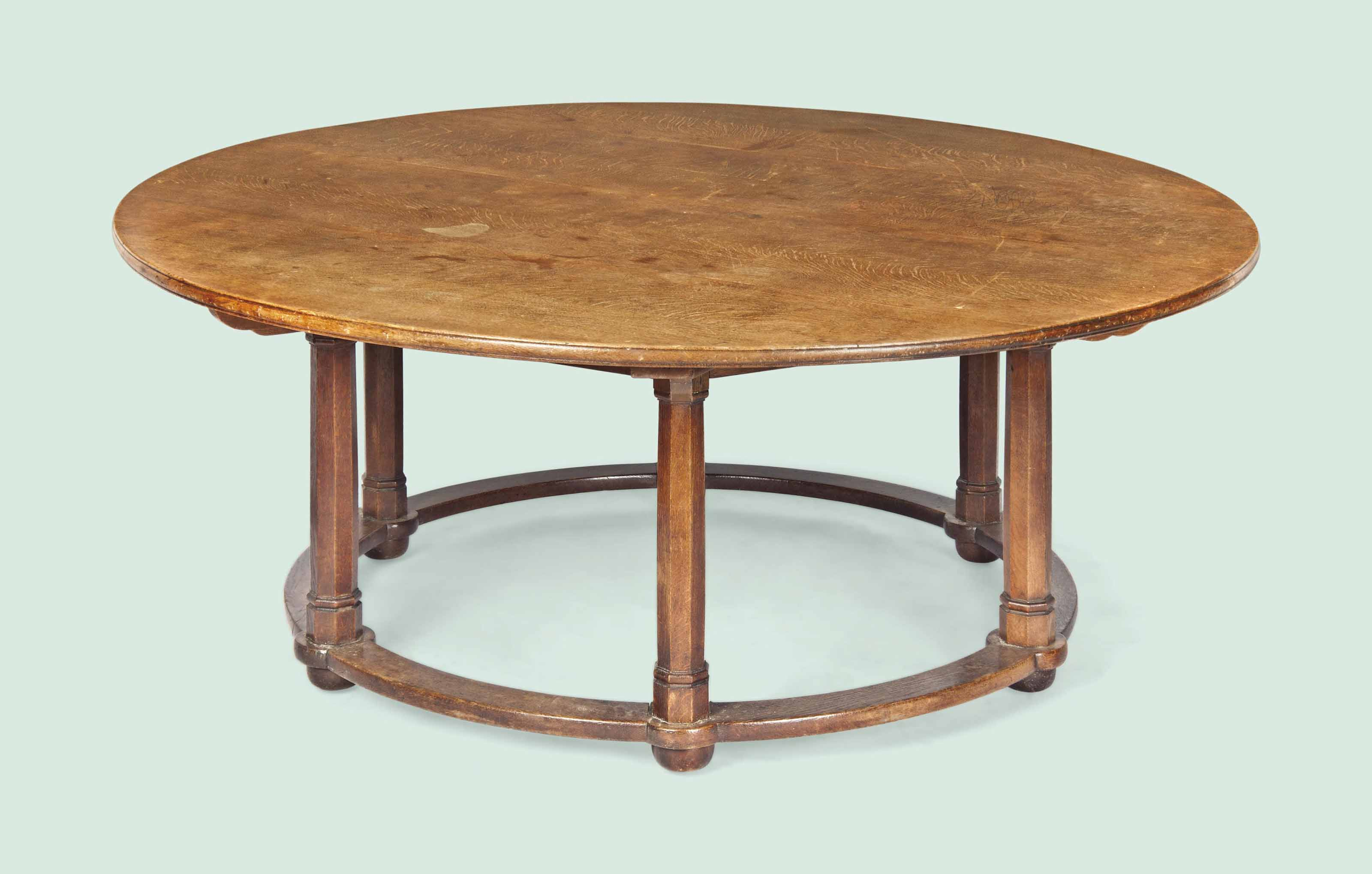 A LARGE ARTS AND CRAFTS OAK DINING TABLE