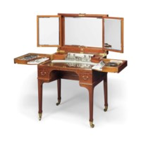 A GEORGE V SILVER-FITTED MAHOGANY DRESSING TABLE