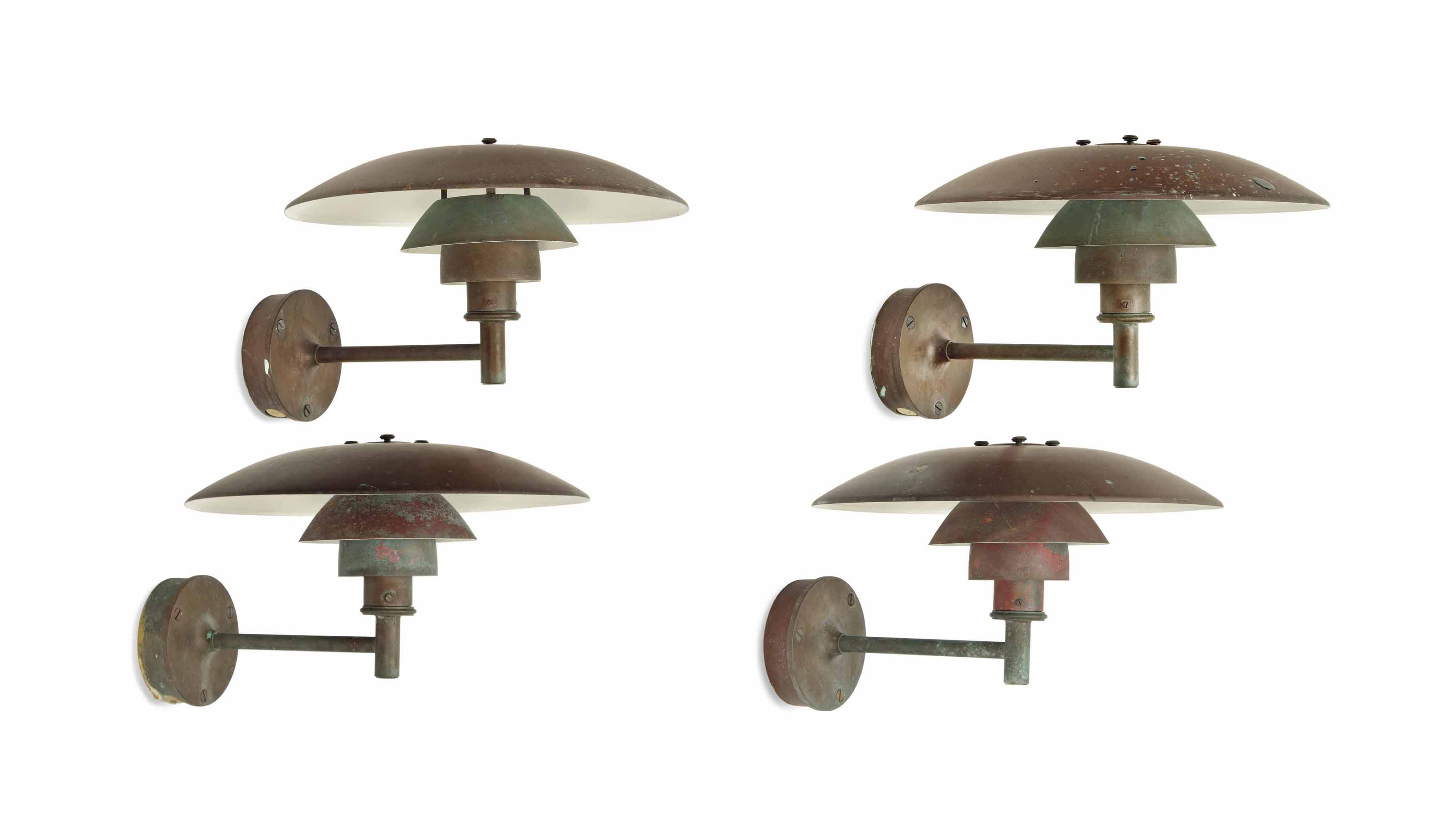 A SET OF FOUR POUL HENNINGSEN (1894-1967) COPPER OUT DOOR WALL APPLIQUES