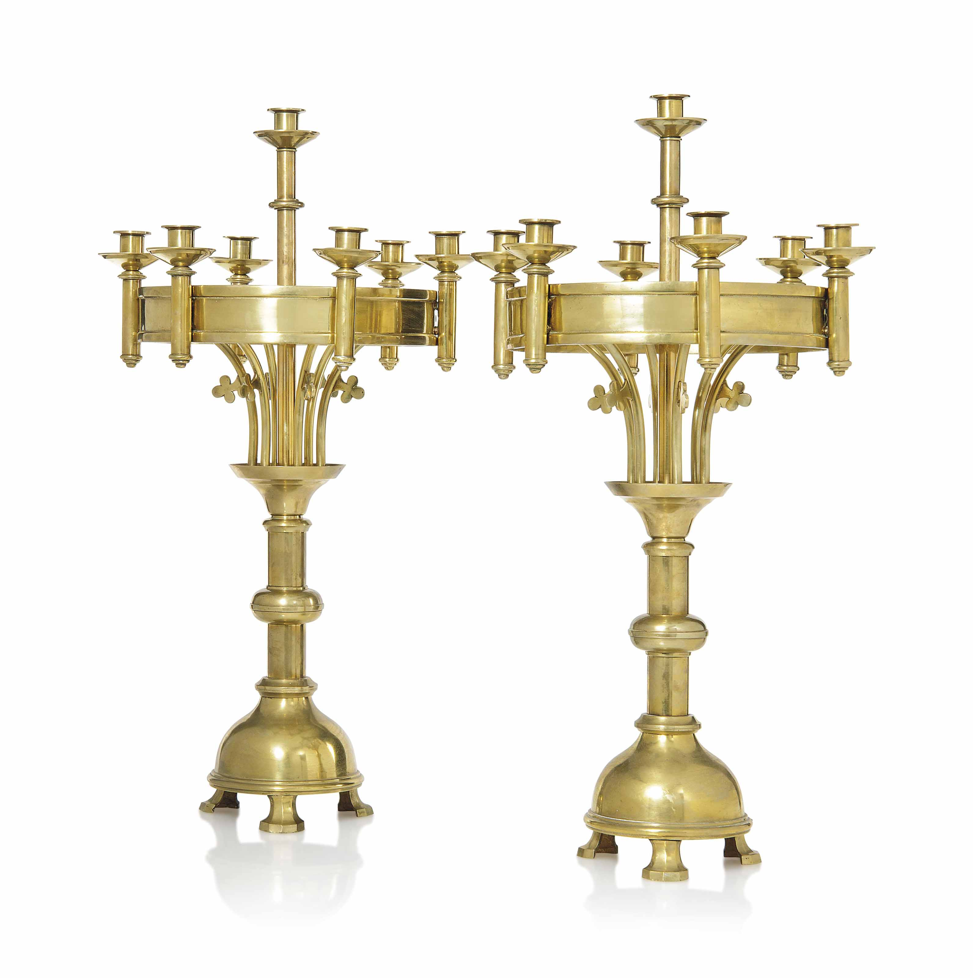 A LARGE PAIR OF GOTHIC REVIVAL BRASS CANDELABRA