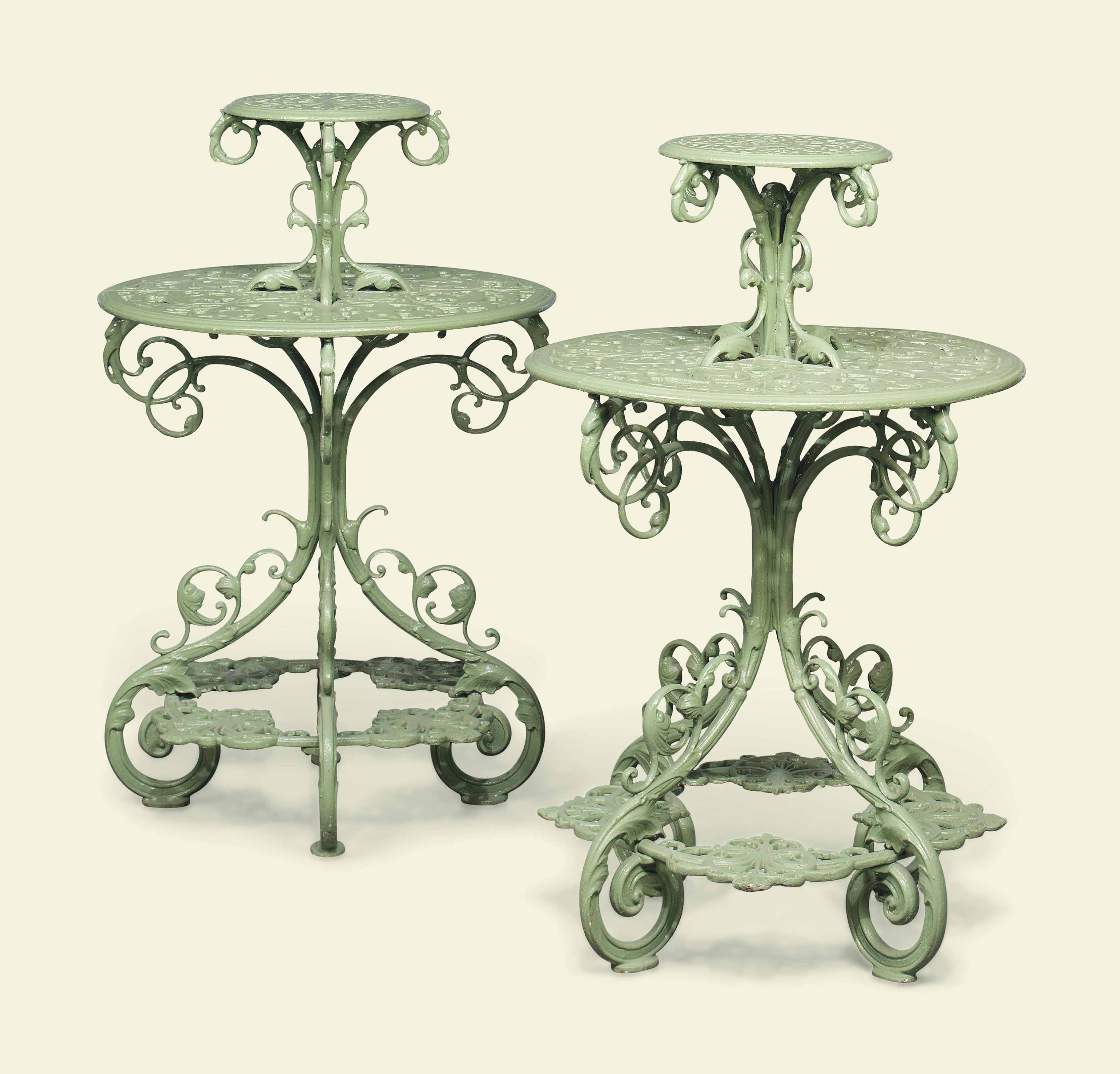 A PAIR OF VICTORIAN TWO-TIER PLANT STANDS