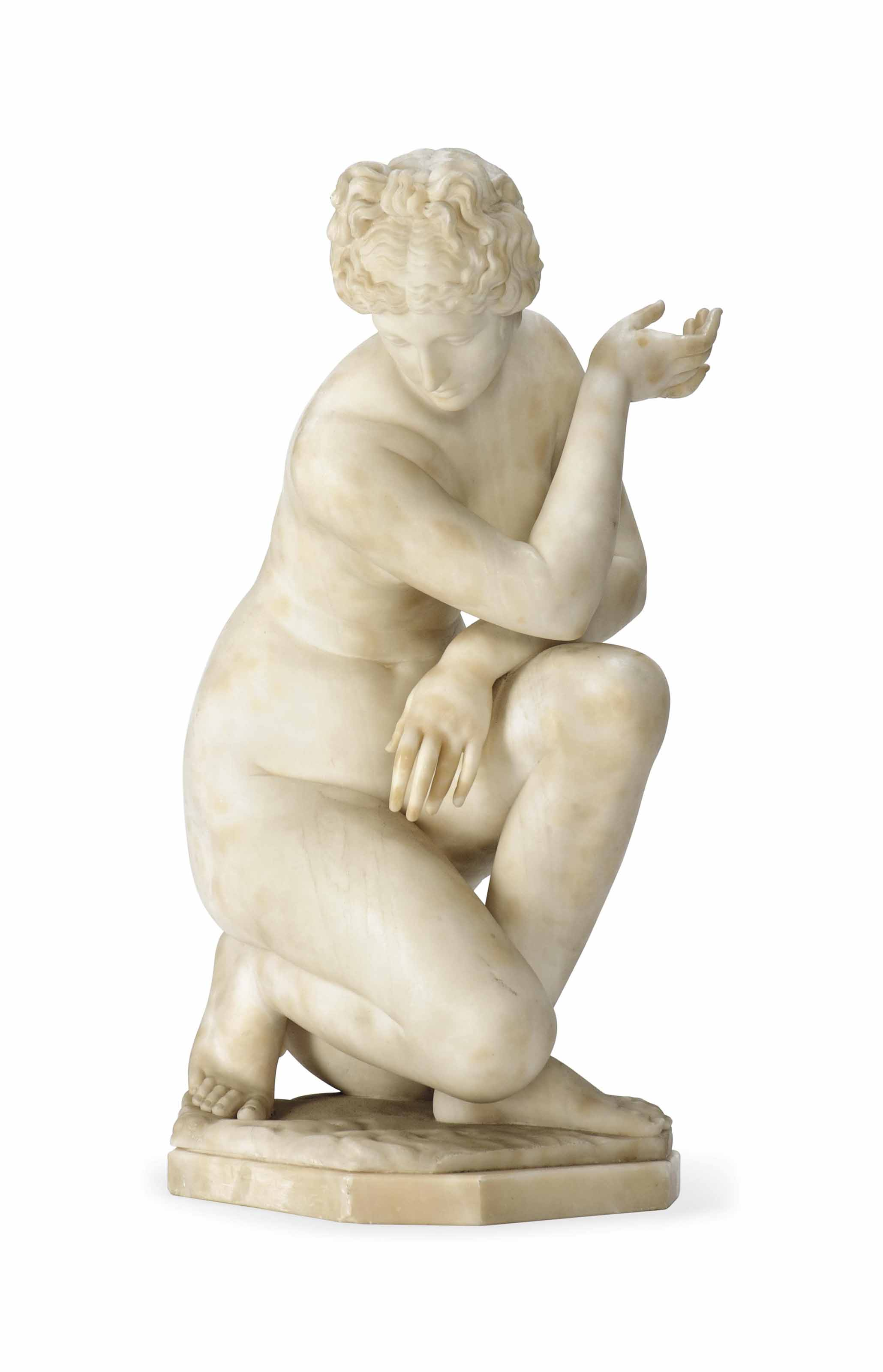 AN ITALIAN CARVED ALABASTER FIGURE OF THE CROUCHING VENUS