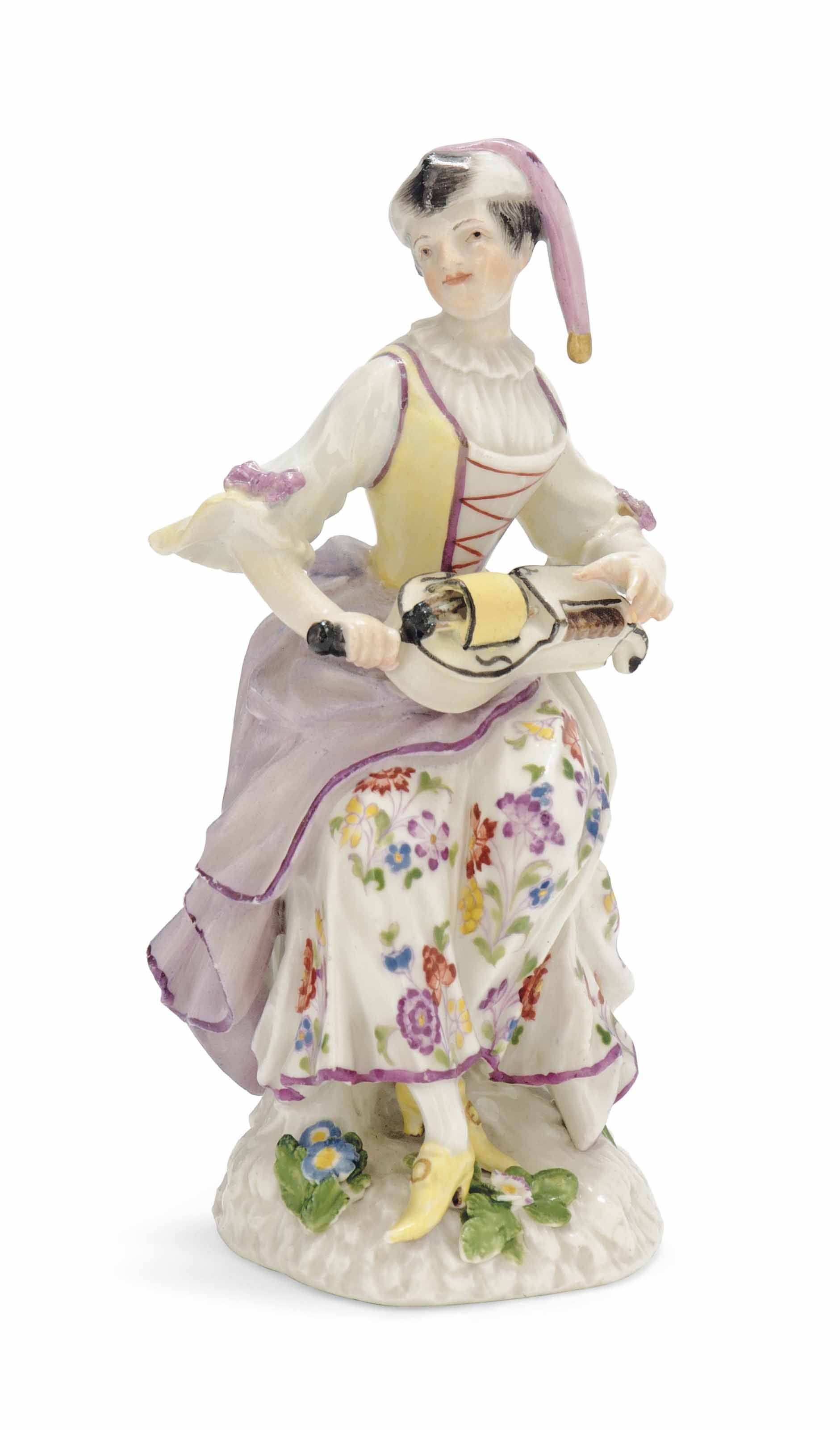 A MEISSEN FIGURE OF A FEMALE H