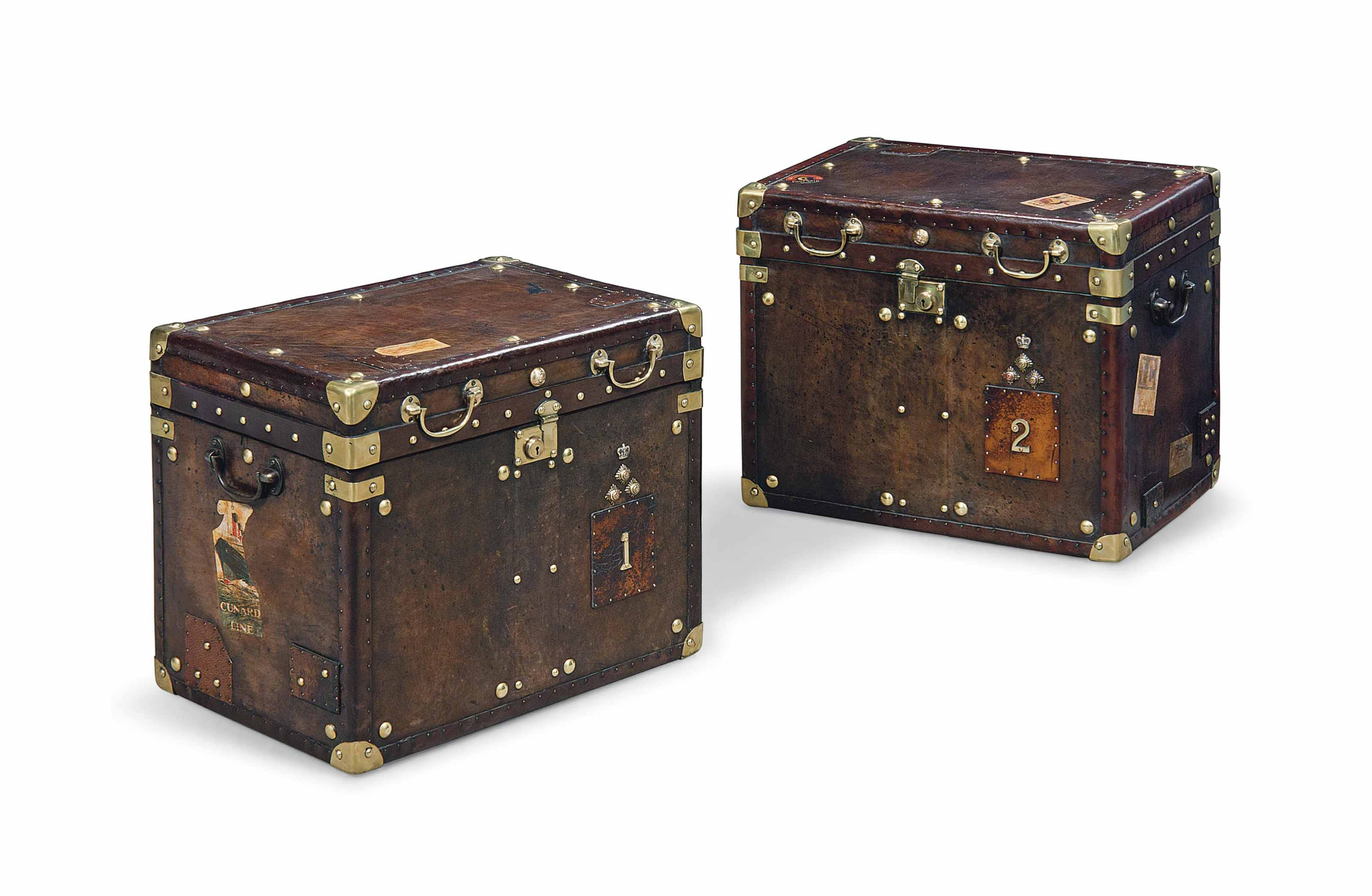 A PAIR OF ENGLISH BRASS-BOUND LEATHER TRUNKS