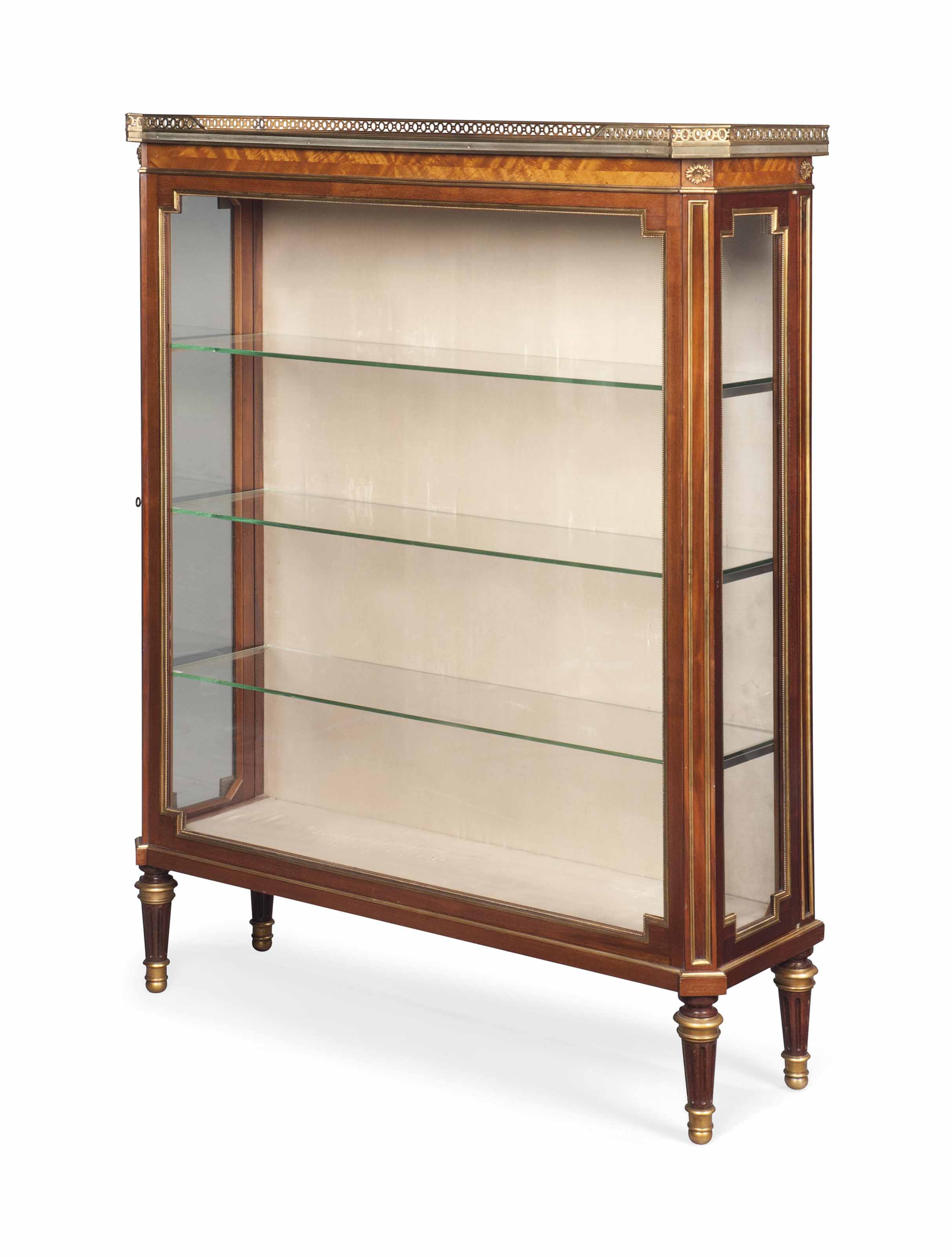 A LATE VICTORIAN BRASS- AND ORMOLU-MOUNTED MAHOGANY DISPLAY CABINET