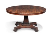 A REGENCY ROSEWOOD BREAKFAST TABLE