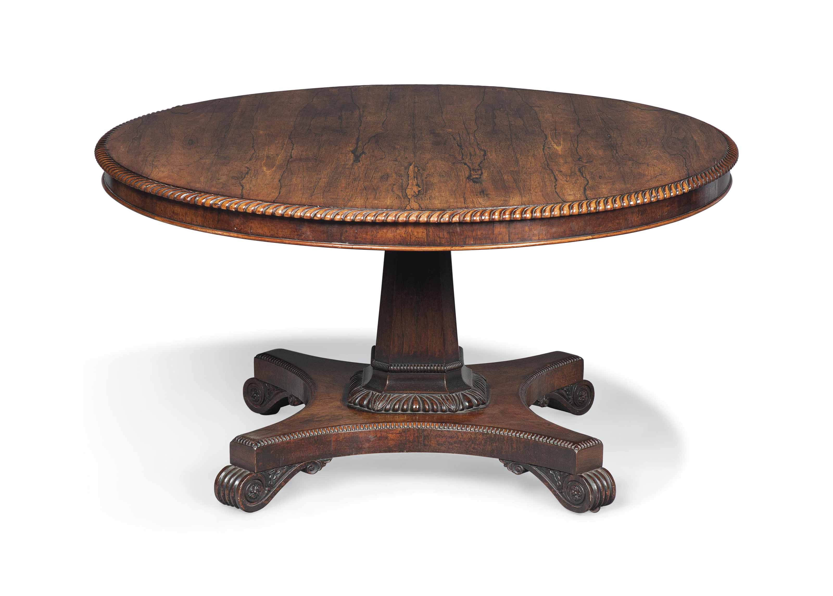 A REGENCY ROSEWOOD BREAKFAST TABLE