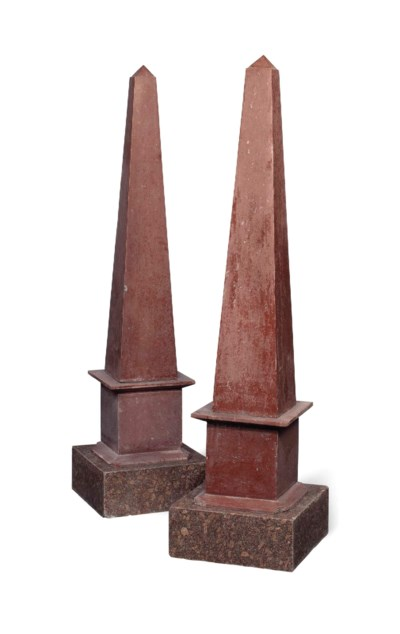 A LARGE PAIR OF RED MARBLE OBE
