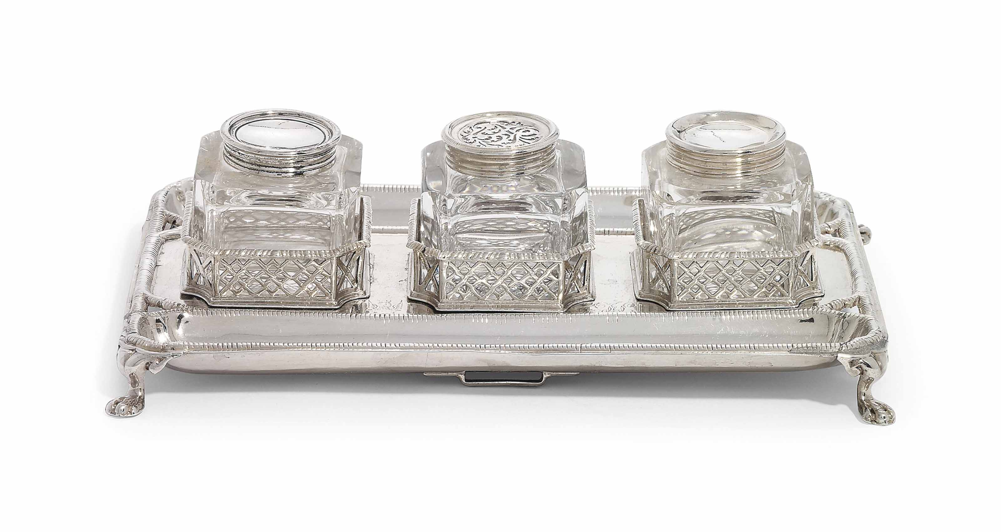 A GEORGE III SILVER OBLONG INKSTAND