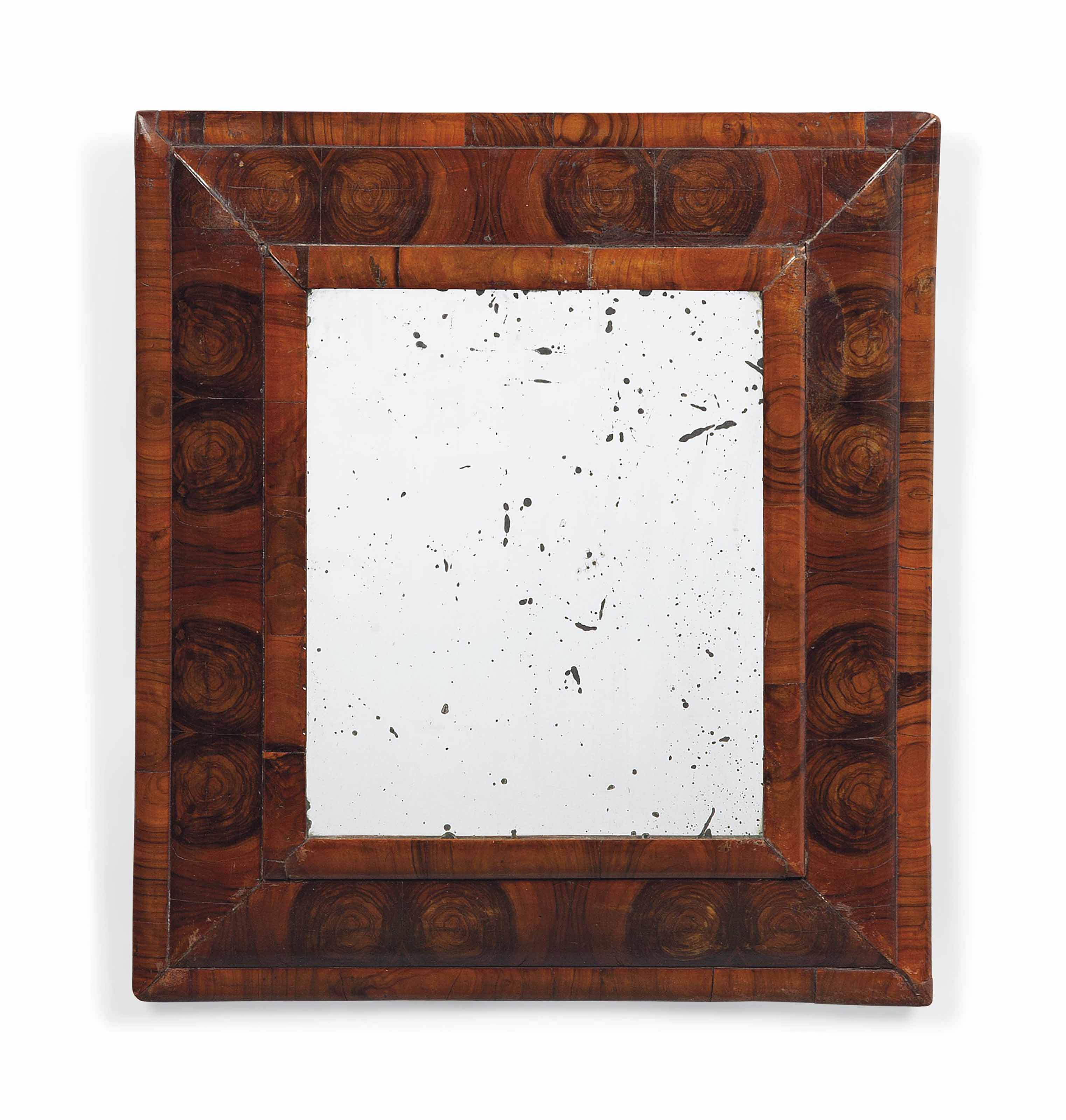 A WILLIAM AND MARY WALNUT OYSTER-VENEERED MIRROR