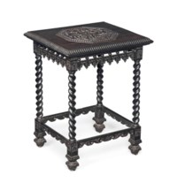 AN ANTIQUARIAN EBONY OCCASIONAL TABLE