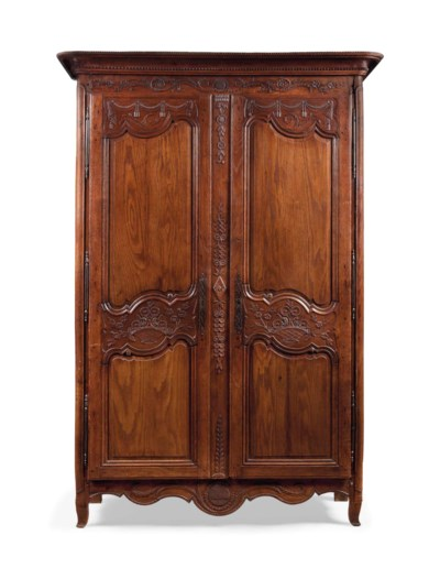A FRENCH OAK ARMOIRE