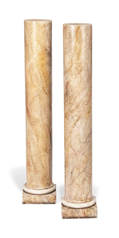 A PAIR OF SIMULATED MARBLE WOO