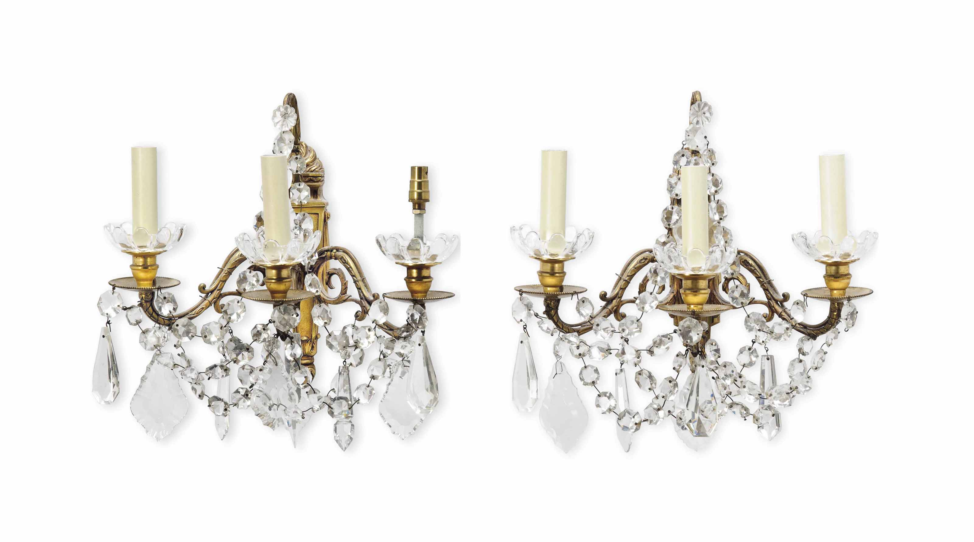 A PAIR OF FRENCH GILT-BRONZE AND GLASS THREE-LIGHT WALL APPLIQUES