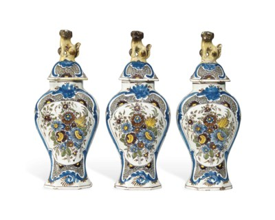 A GARNITURE OF DUTCH DELFT POL