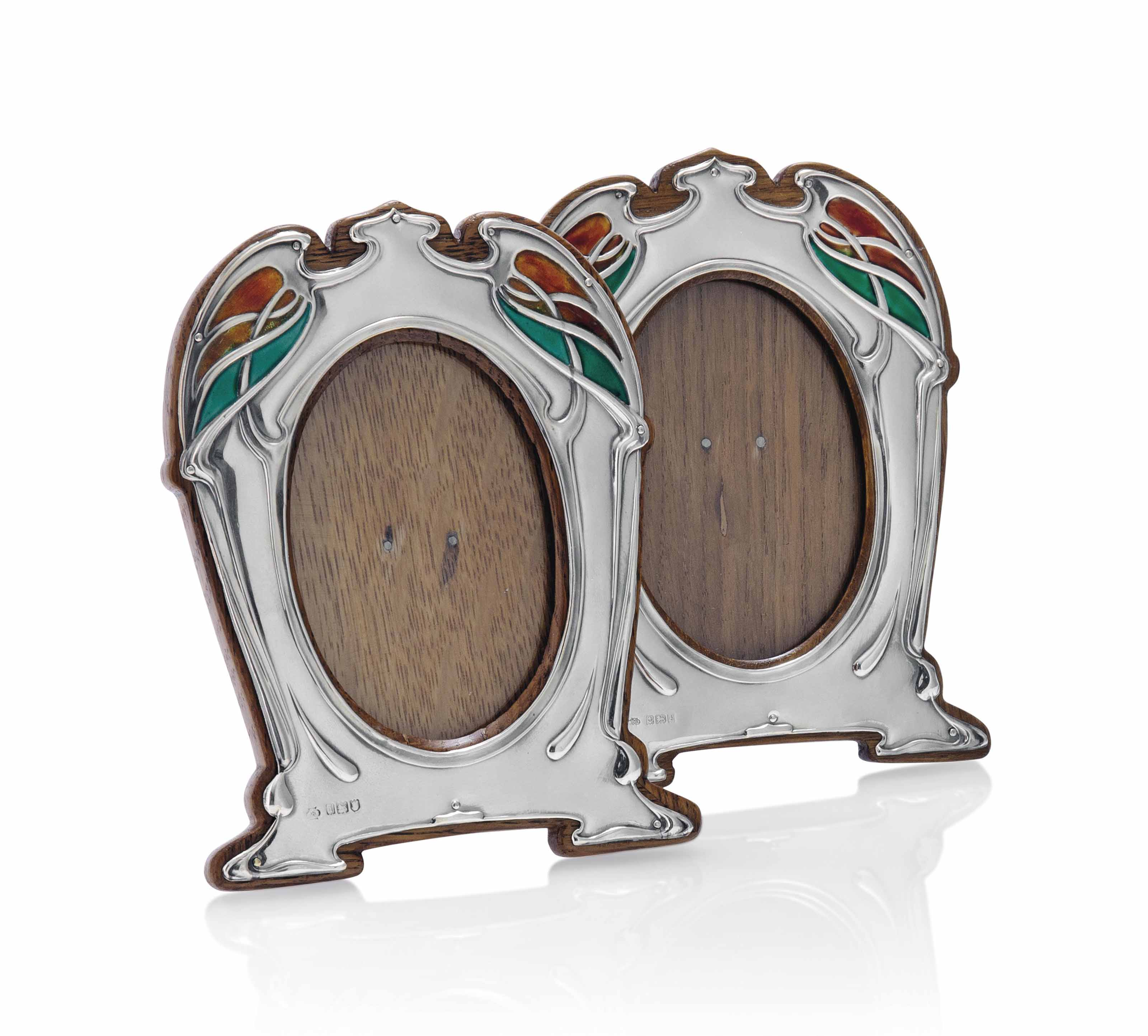 A PAIR OF WILLIAM HUTTON & SONS LTD SILVER AND ENAMEL PHOTOGRAPH FRAMES