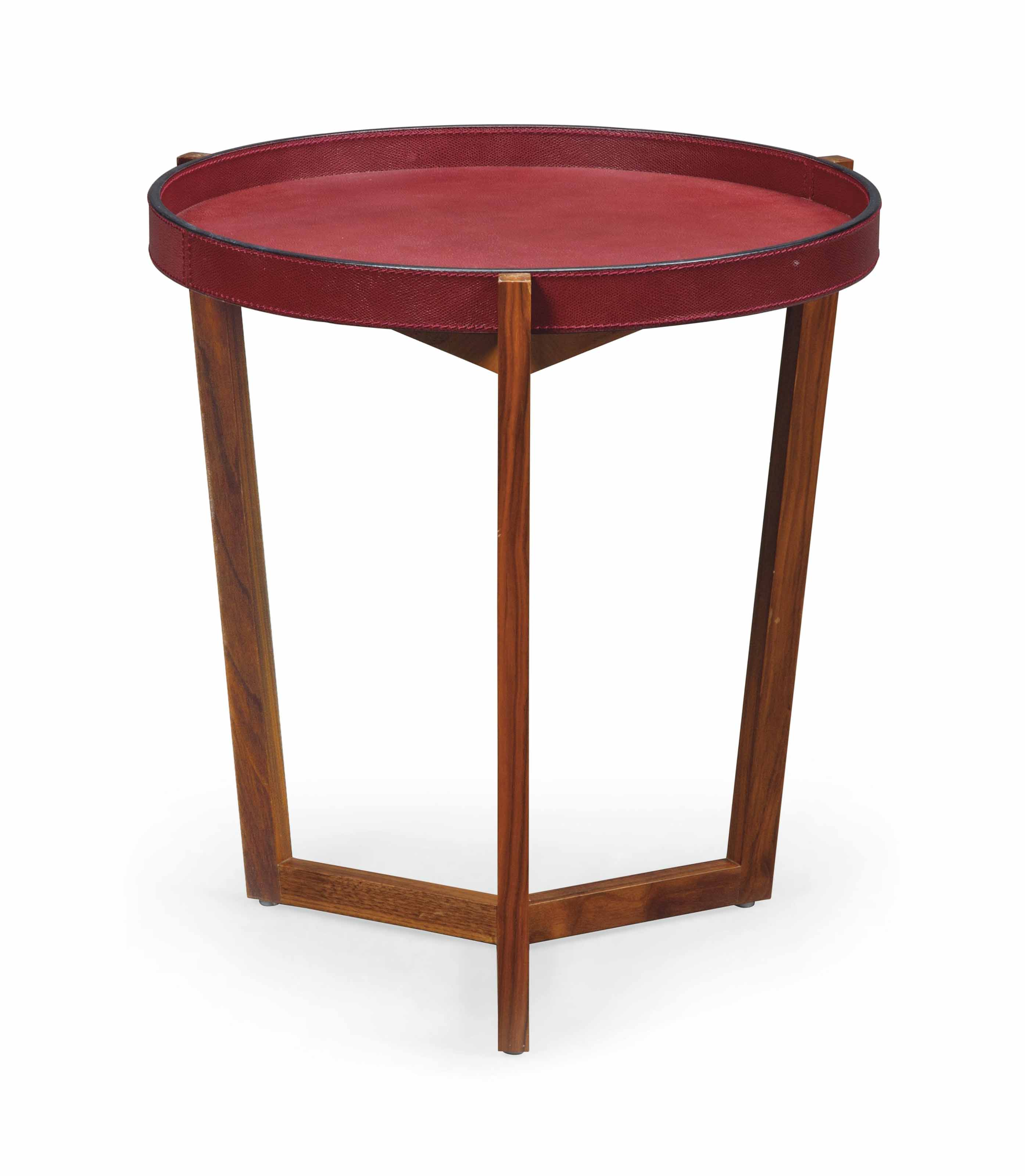A WALNUT AND BURGUNDY LEATHER OCCASIONAL TABLE