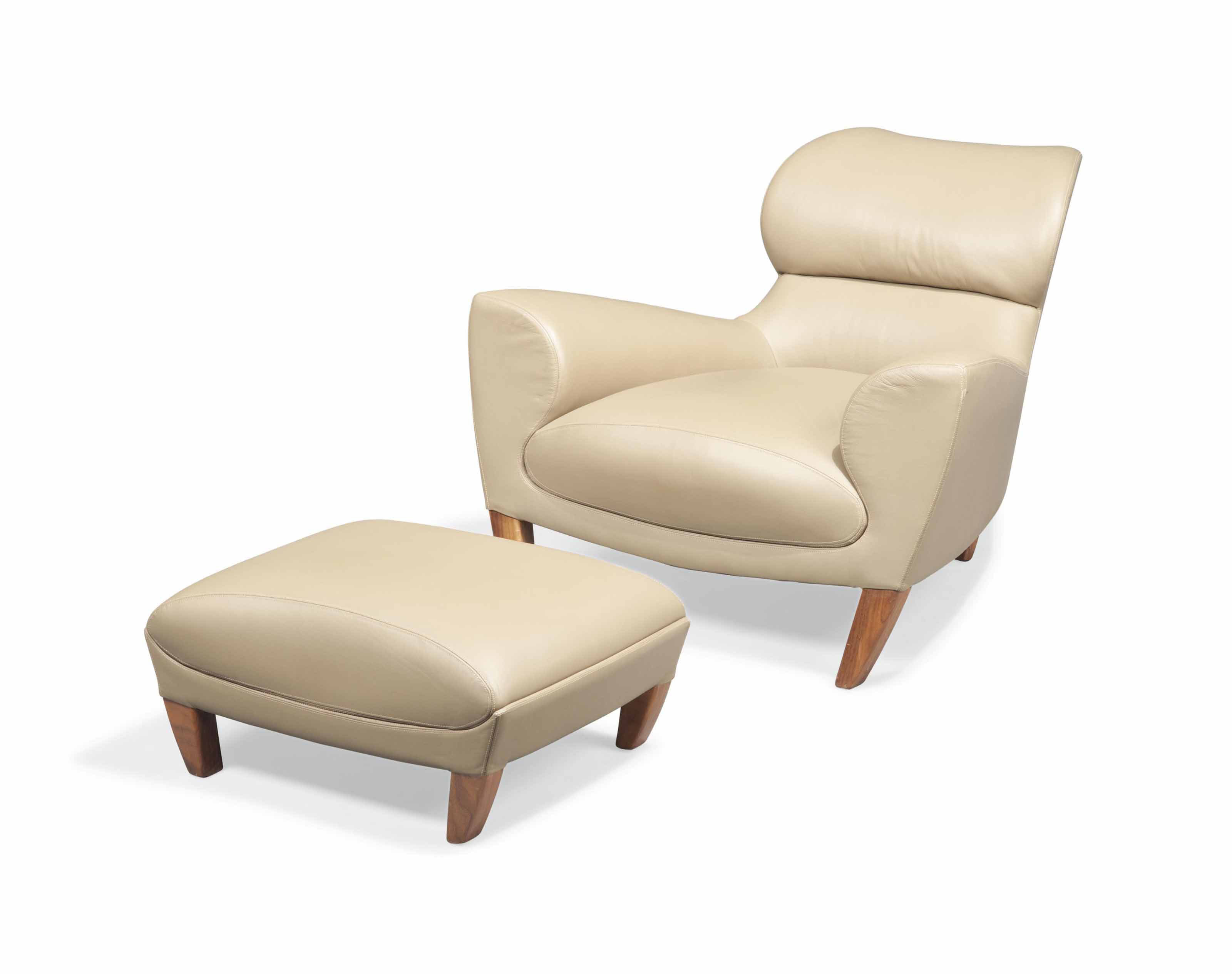 AN 'ASTONETTE' ARMCHAIR AND FOOTSTOOL