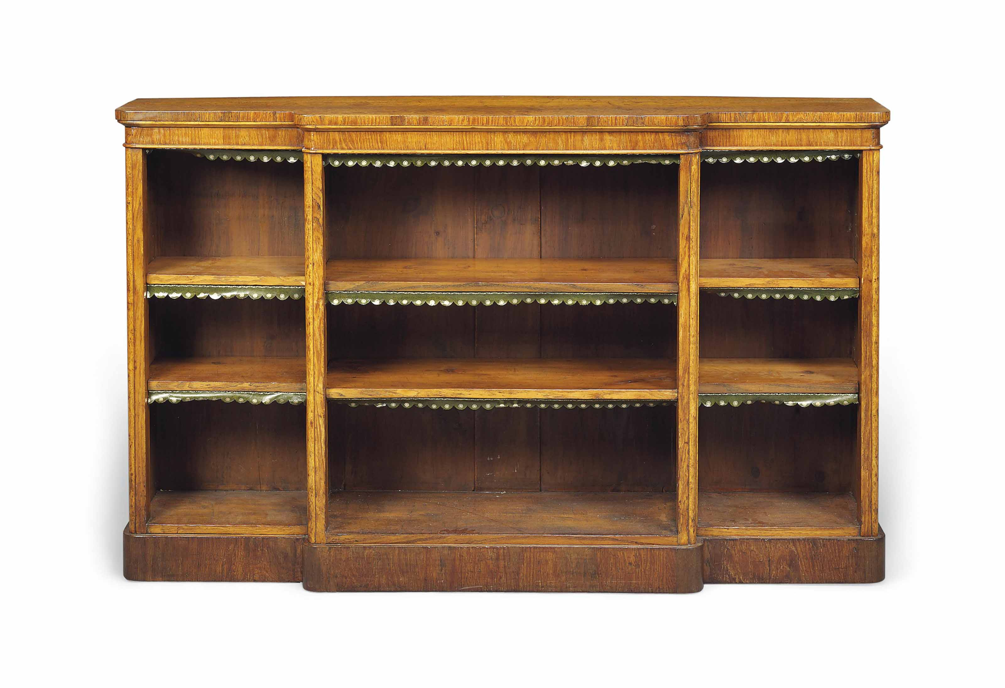 A VICTORIAN OAK BREAKFRONT OPEN BOOKCASE
