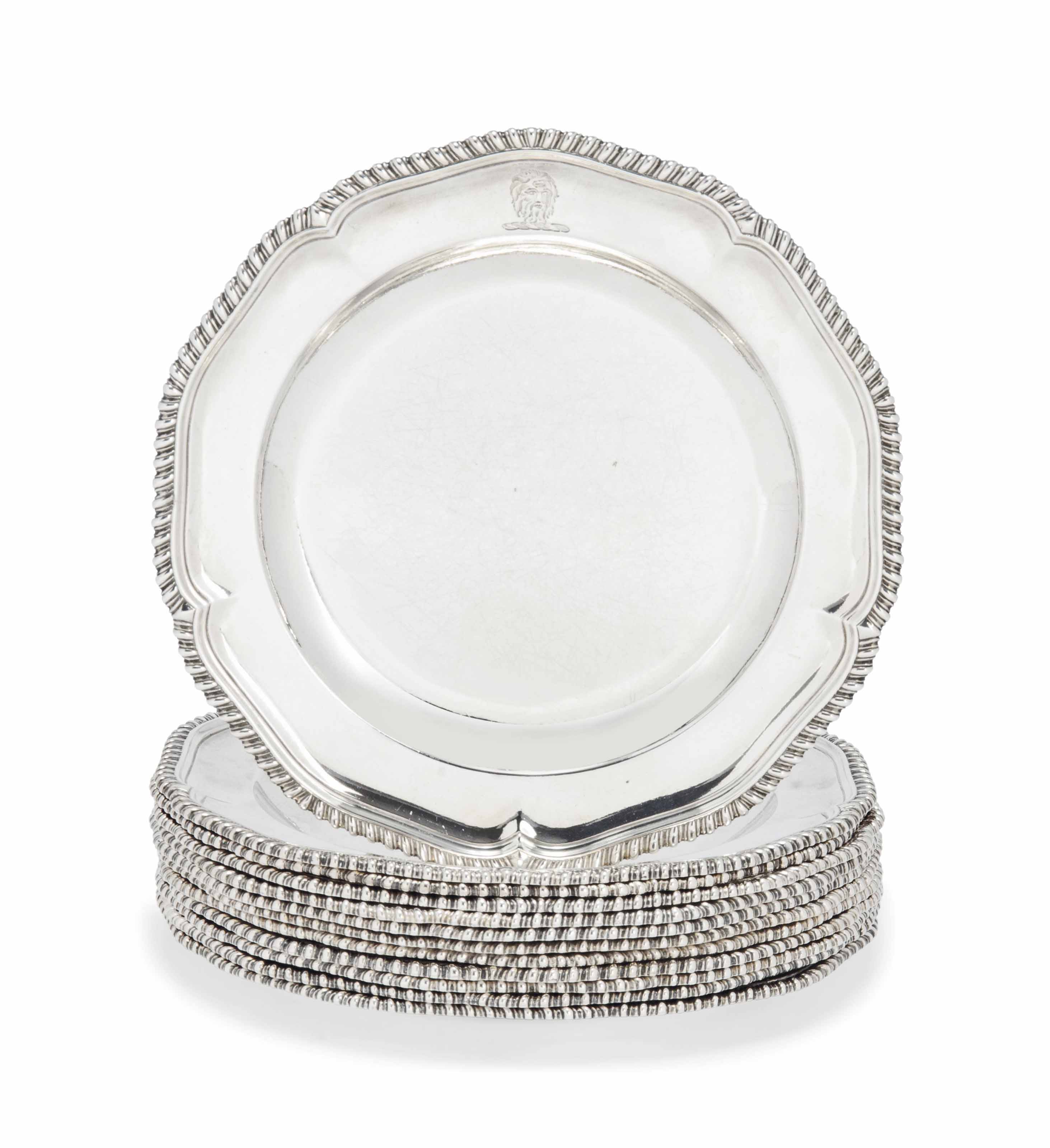 A SET OF ELEVEN GEORGE III SILVER DINNER PLATES