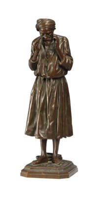 A FRENCH ORIENTALIST BRONZE FIGURE OF A MAN AT PRAYER
