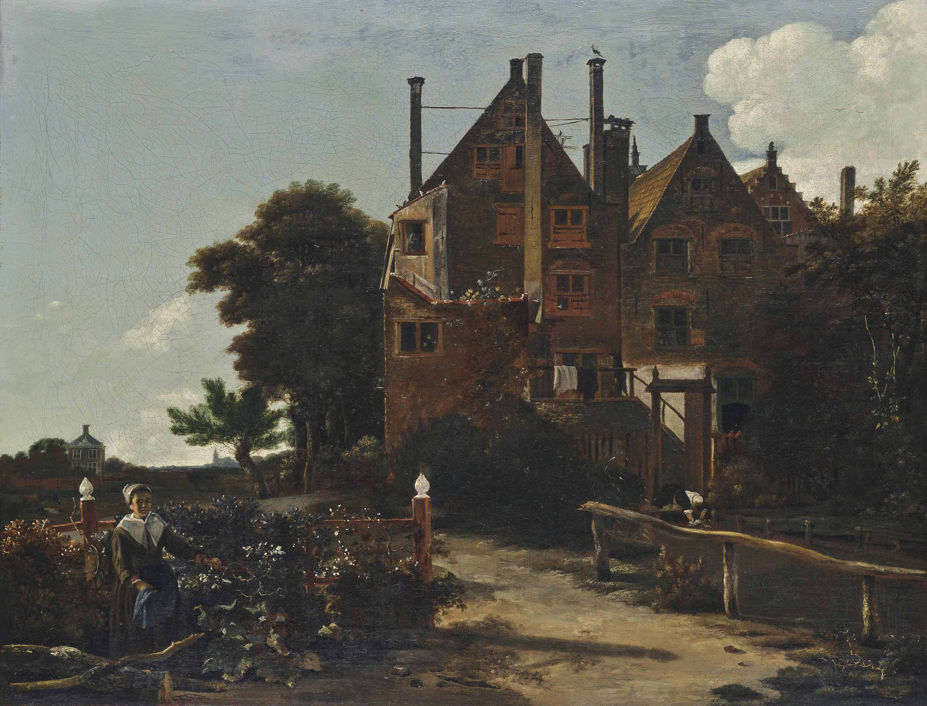 A wooded landscape with washerwomen beside a house