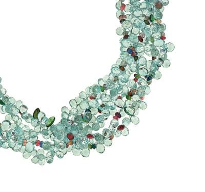 An aquamarine and gem torsade