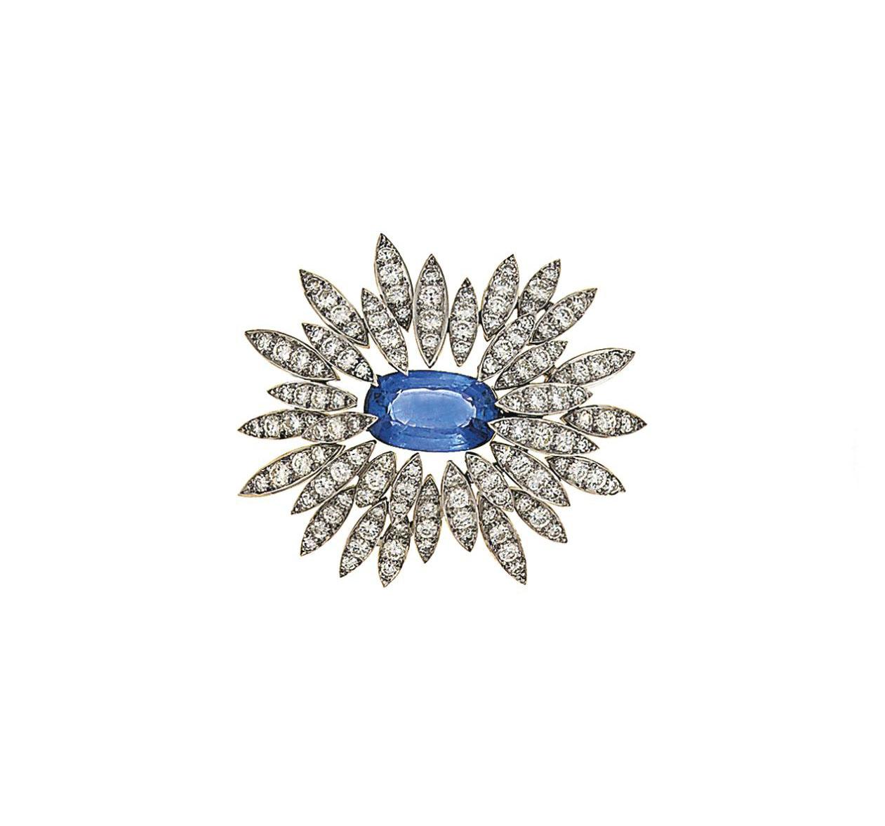 A sapphire and diamond brooch,