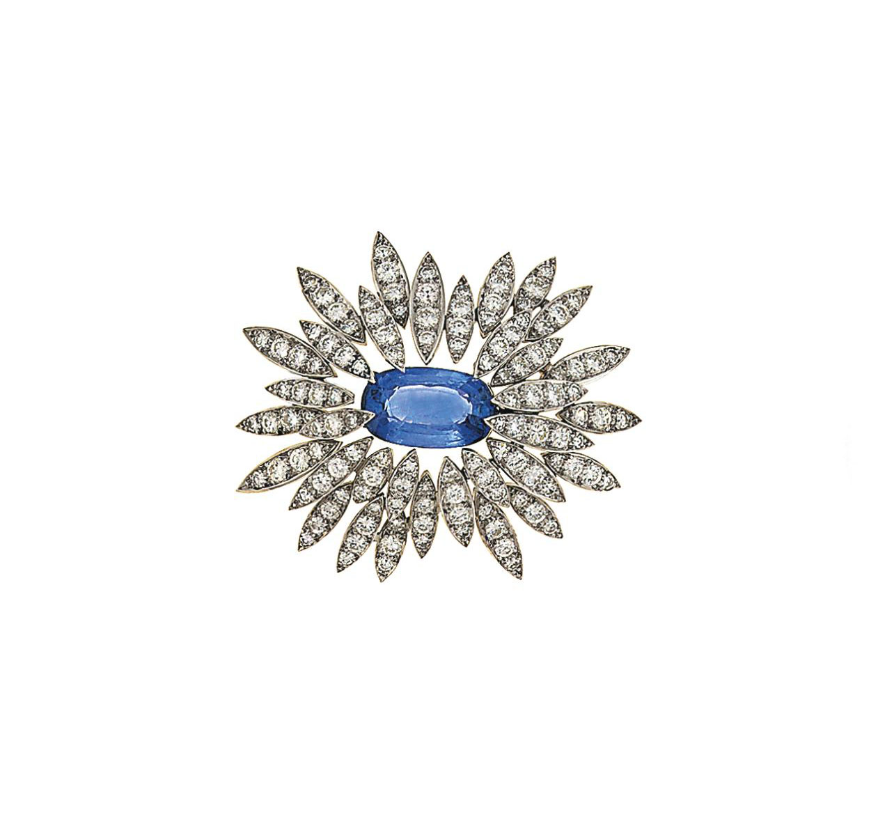 A sapphire and diamond brooch, by  Andrew Grima