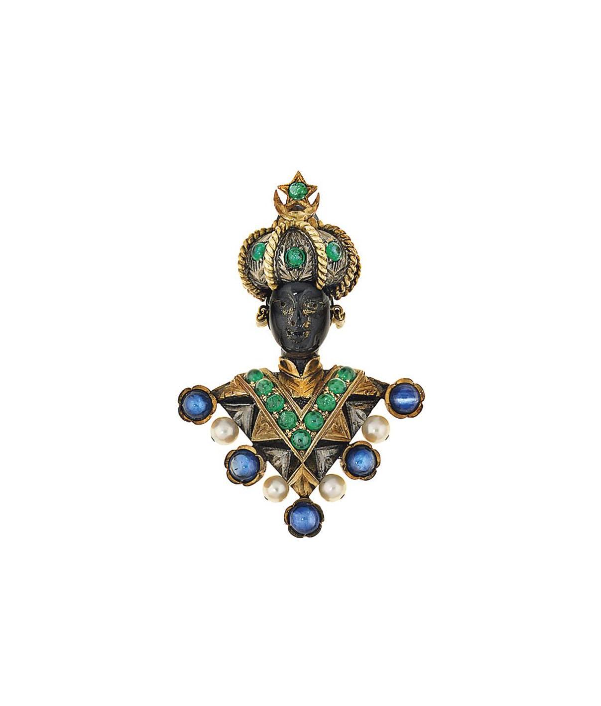 A sapphire, emerald, cultured