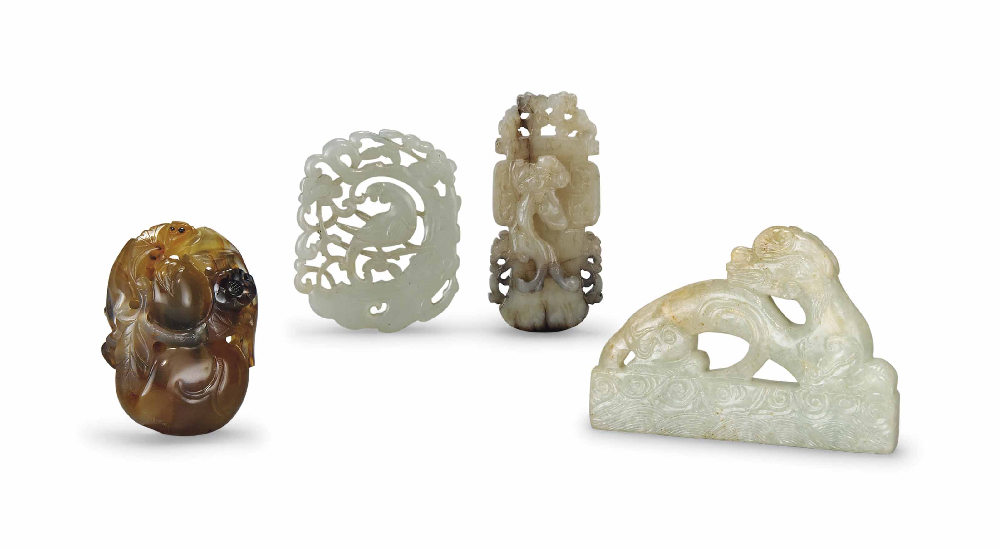 THREE CELADON JADE PLAQUES, AND AN AGATE CARVING