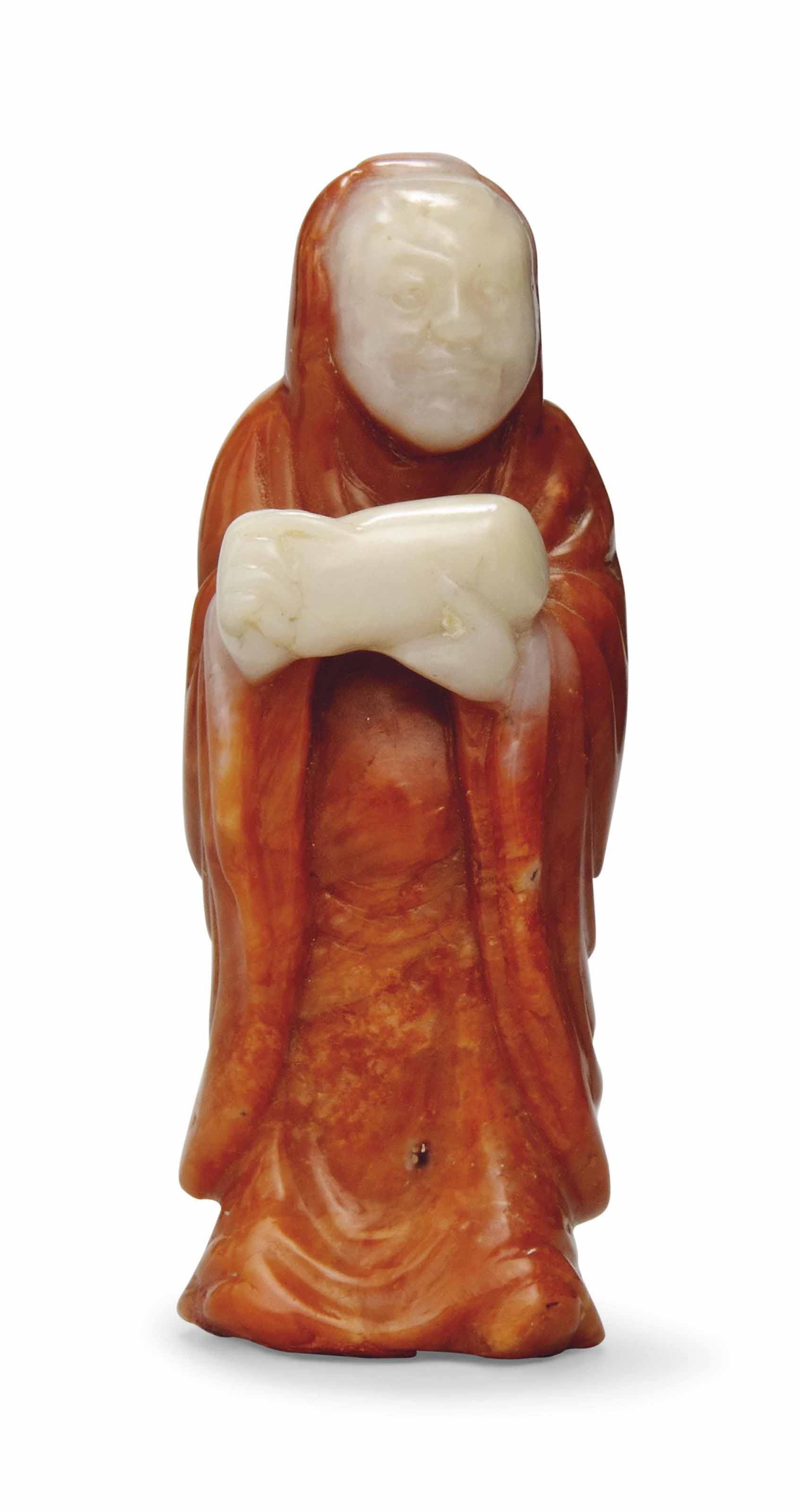 A CARNELIAN AGATE CARVING OF A