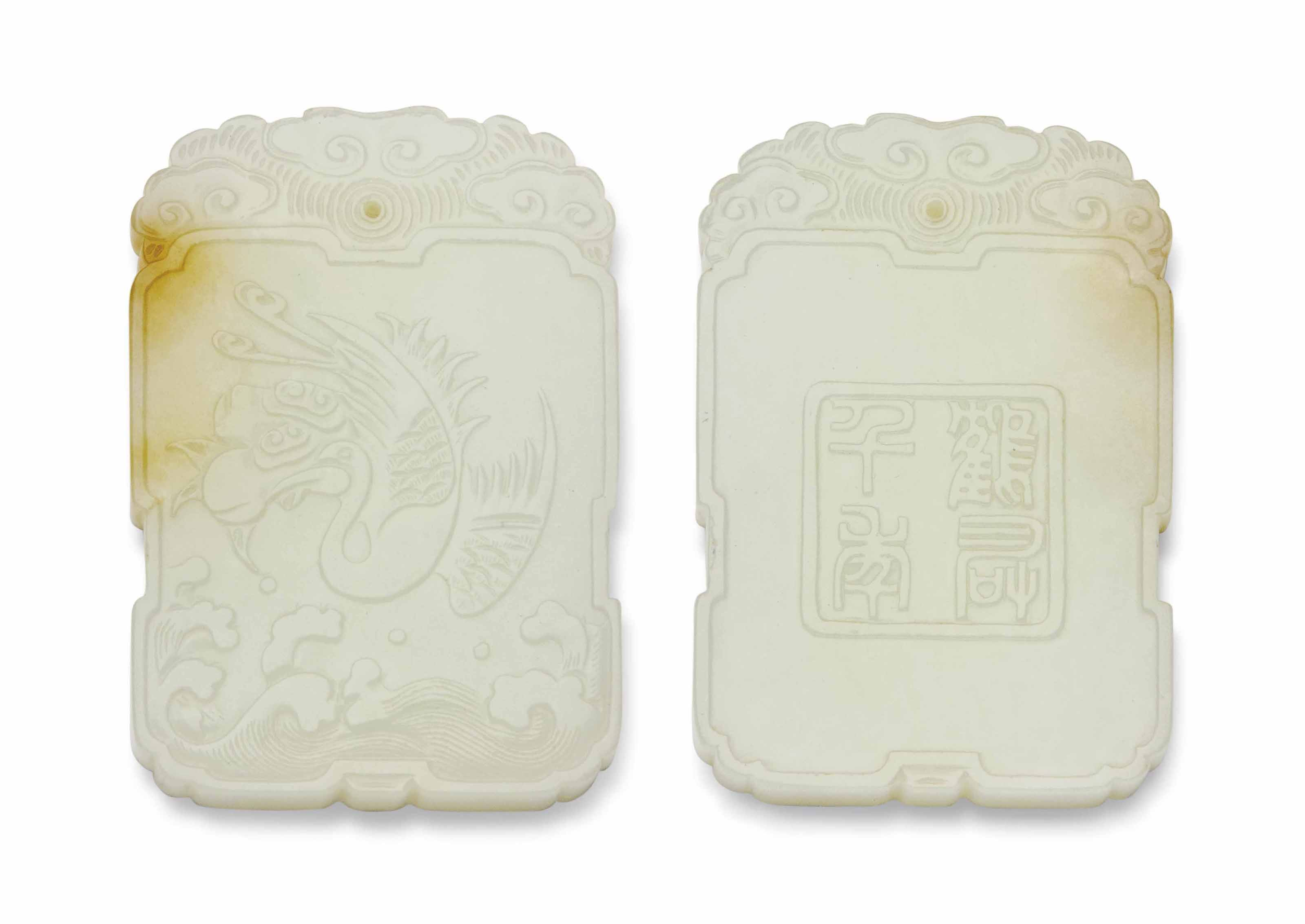 A WHITE AND RUSSET JADE PLAQUE