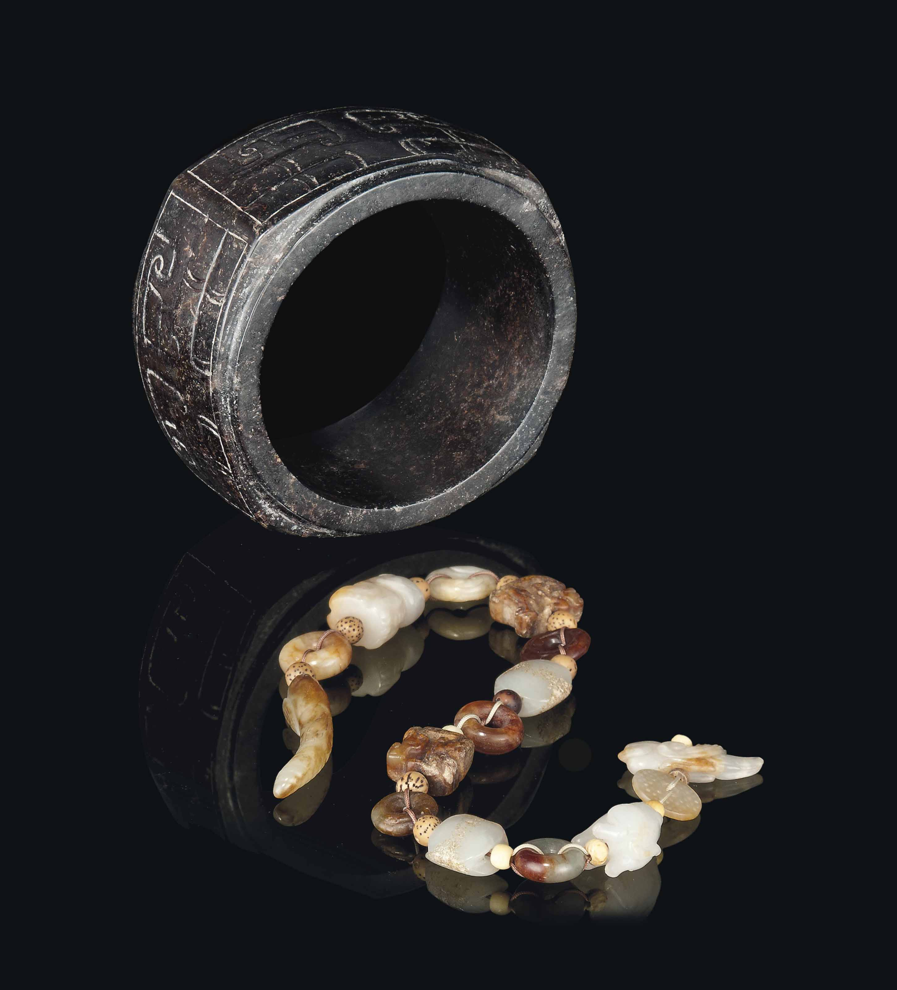 A DARK BROWN JADE CONG AND FIF