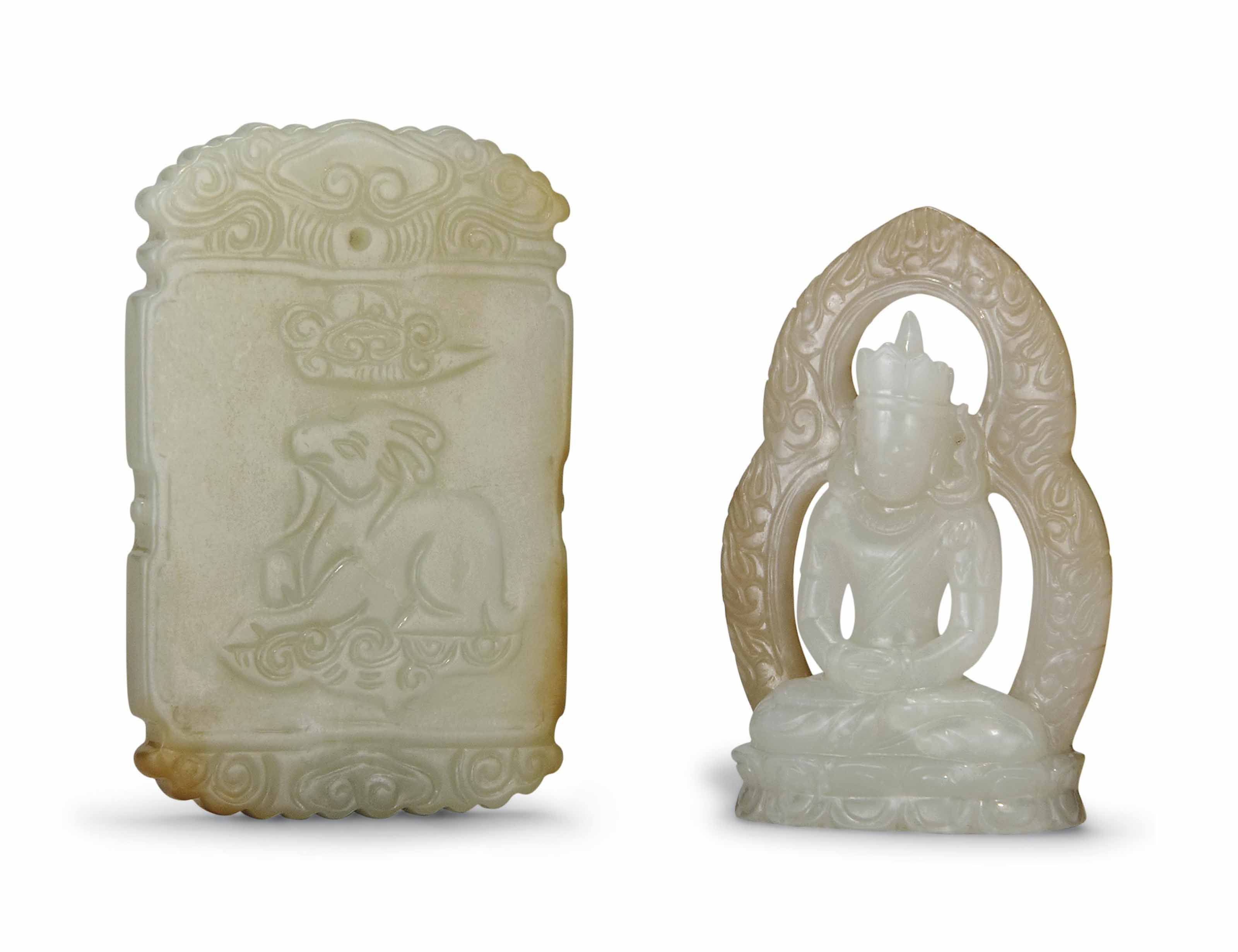 A WHITE AND RUSSET JADE SEATED