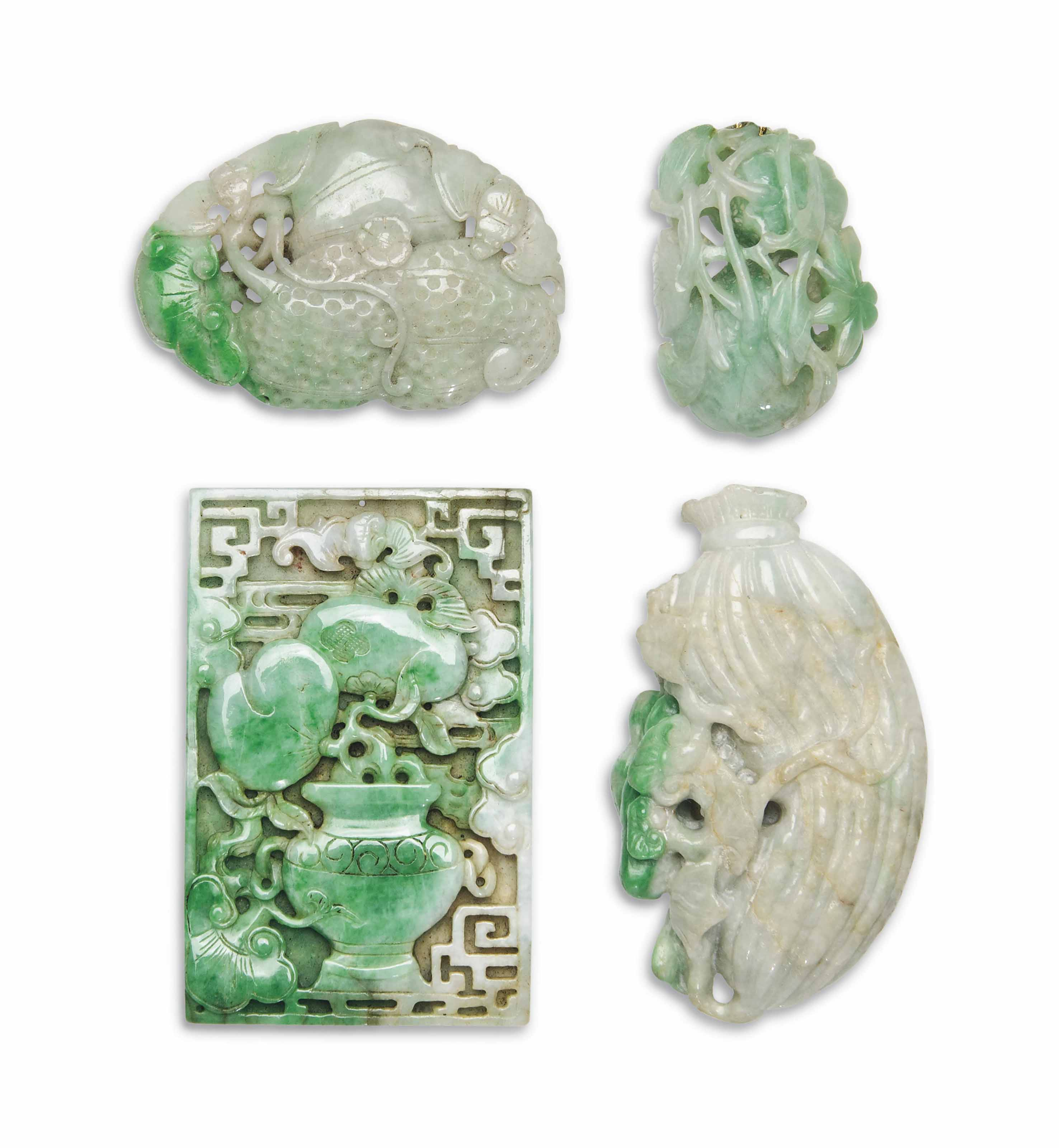 A GROUP OF FOUR GREEN JADEITE