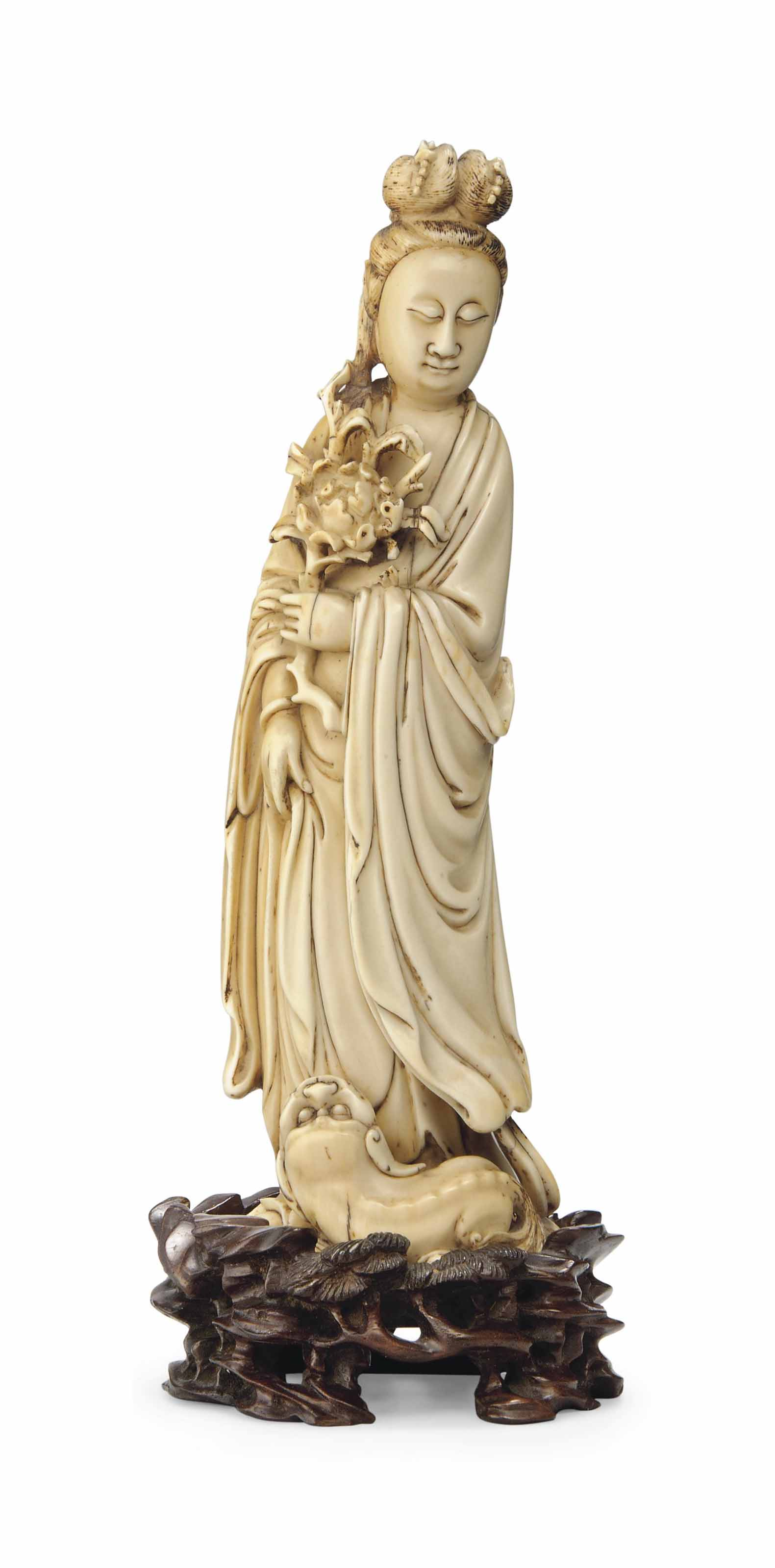 AN IVORY FIGURE OF GUANYIN
