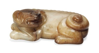 A JADE CARVING OF A RECLINING