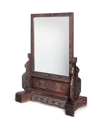 A LARGE HARDWOOD FLOOR MIRROR