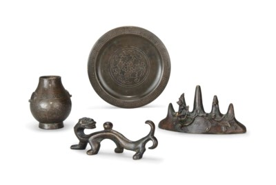 TWO BRONZE BRUSH RESTS, A SHIS