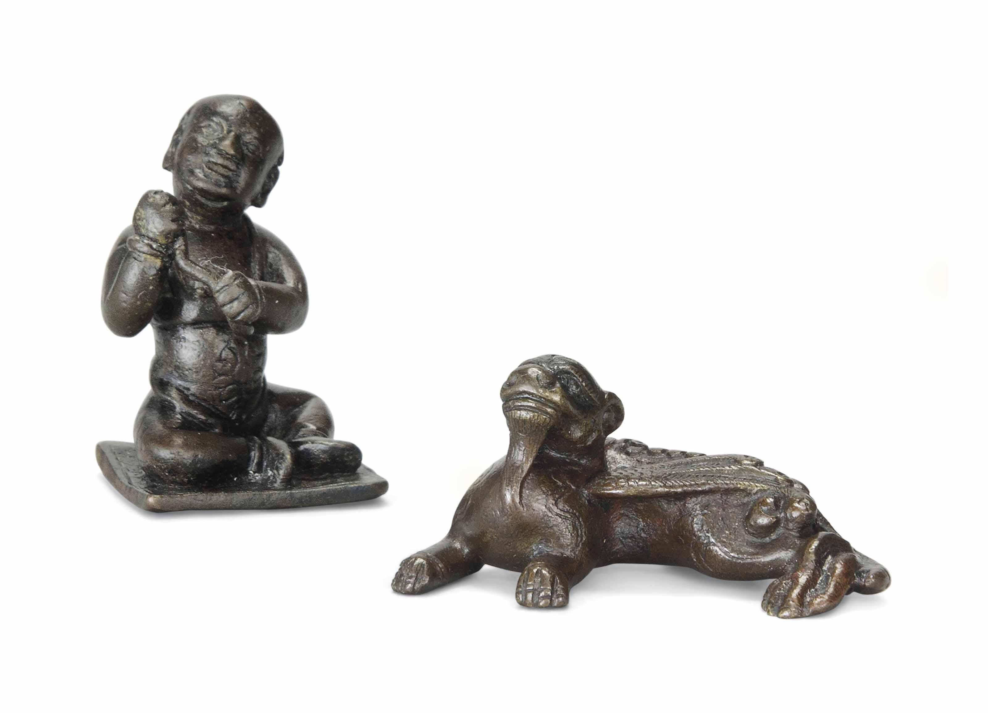 A BRONZE FIGURE OF A MYTHICAL