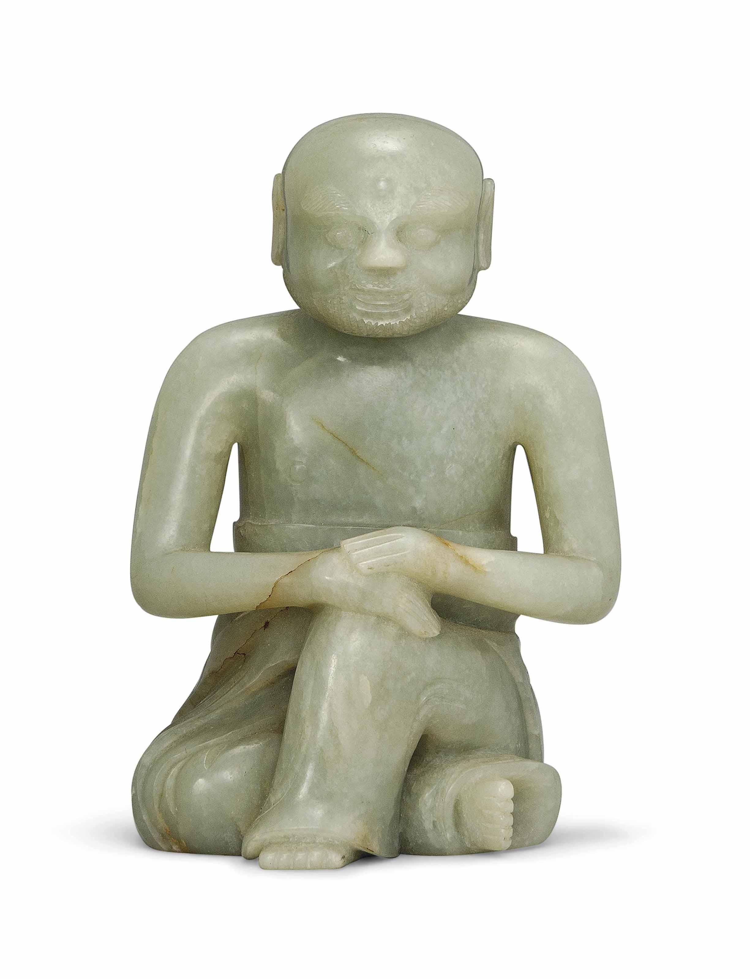 A CELADON JADE BUDDHIST FIGURE