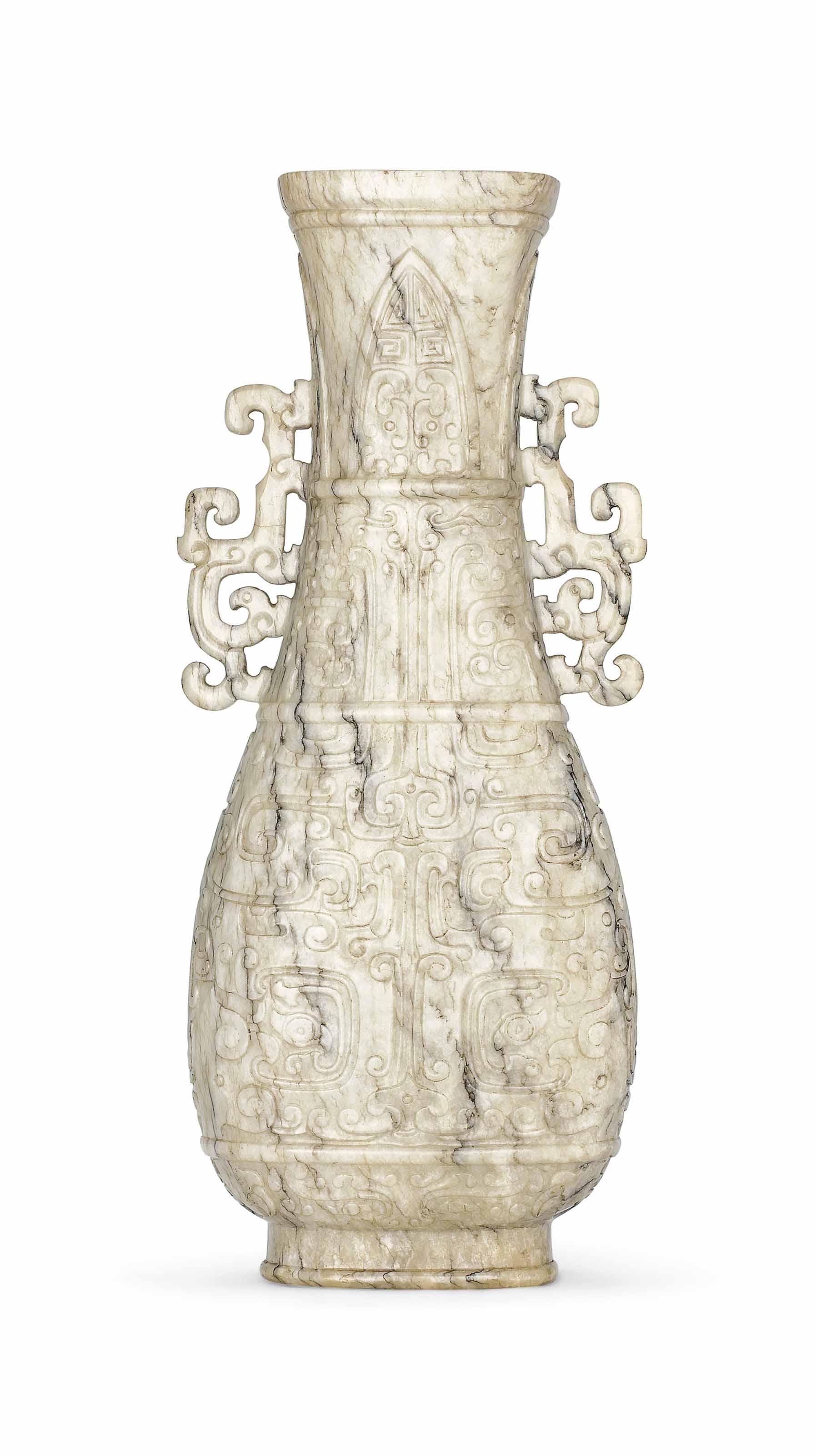 A CHICKEN BONE JADE ARCHAISTIC